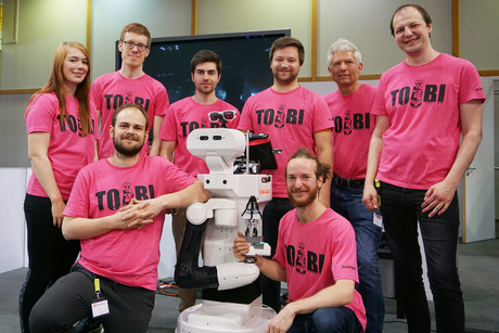 "The ""Team of Bielefeld"" competed in the tournament with robot model TI-AGo. Dr.-Ing. Sven Wachsmuth heads the team.  (2nd from right). Photo: CITEC/Bielefeld University"