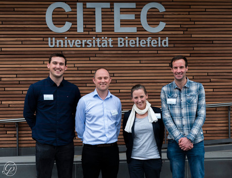 Dr. Cornelia Frank (second from right), organizer of this year's RIO conference, pictured in front of the CITEC Building with RIO group organizers (from left): Dr. Adam Bruton, Dr. Daniel Eaves and Dr. David Wright.