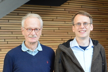 Prof. Dr. Holk Cruse (left) and Dr. Malte Schilling have developed a software architecture to help the walking robot Hector attain different aspects of consciousness. Photo: CITEC/Bielefeld University