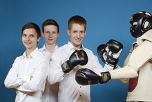 Manuel Rieger, Joseph Beerel, Karl Christian Lautenschläger (from left) with MC RoBeK, the combat sports and self-defense  training robot they developed. Photo: Stiftung Jugend forscht e. V.