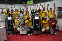 Introducing the best service robot team in the world: CITEC's team took first place in the household service league at the RoboCup world championship. The team competed with robots Tobi (first and third from left), Floka (second from left), and the Amiro mini robots (in front). Photo: CITEC/Bielefeld University