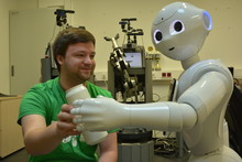 Johannes Kummert and his team hope to be successful with Pepper the robot in next year's competition. This year, the household service robot ToBi (center) placed again in the top three (Photo: CITEC/Bielefeld University).
