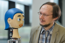 Prof. Dr. Helge Ritter and the robot head Flobi