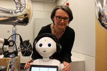 "Prof. Dr.-Ing. Britta Wrede with ""co-moderator"" Pepper the robot in the radio studio"